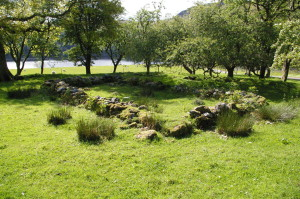 The footings of the chapel walls at Ardtaraig lie in a little wooded enclosure on the loch-side.