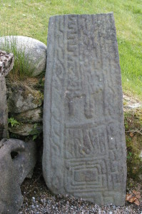 A grave-slab at Cairndow was probably brought there from the old kirk site of Kilmorich. Now broken in two it lies behind the kirk, propped against the wall.