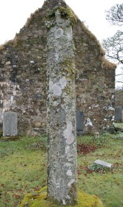 A fifteenth-century stone cross, damaged at the top, stands at Kilmorie