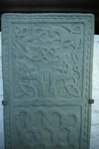 Interlaced animals enliven a medieval grave-slab at Kilmodan. At the top a unicorn defends itself against a (?) wolf.