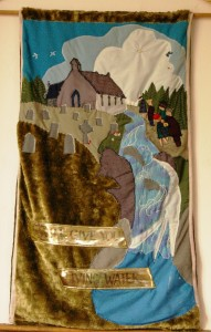A banner in Kilfianan Church celebrates both the church and the river that flows below it as a sign of the Living Water given by Christ, the gift of the Spirit. Given that wisdom is one of the gifts of the Spirit, perhaps one of those fish represents the Salmon of Wisdom.