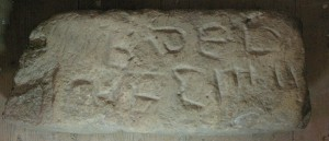 The inscription is hard to read, but may be part of a Roman-lettter alphabet: B, d, E, F and ... L, M, N.