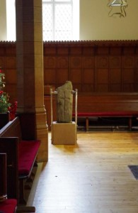 The Kilmun cross-slab now stands in the east of the church, on its plinth of Birchover stone.